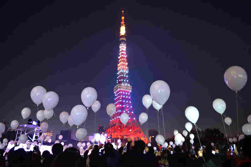 People gather to release balloons to celebrate the New Year during an annual countdown ceremony in Tokyo. Some 2,000 balloons were released in the air, carrying with the visitors' wishes.