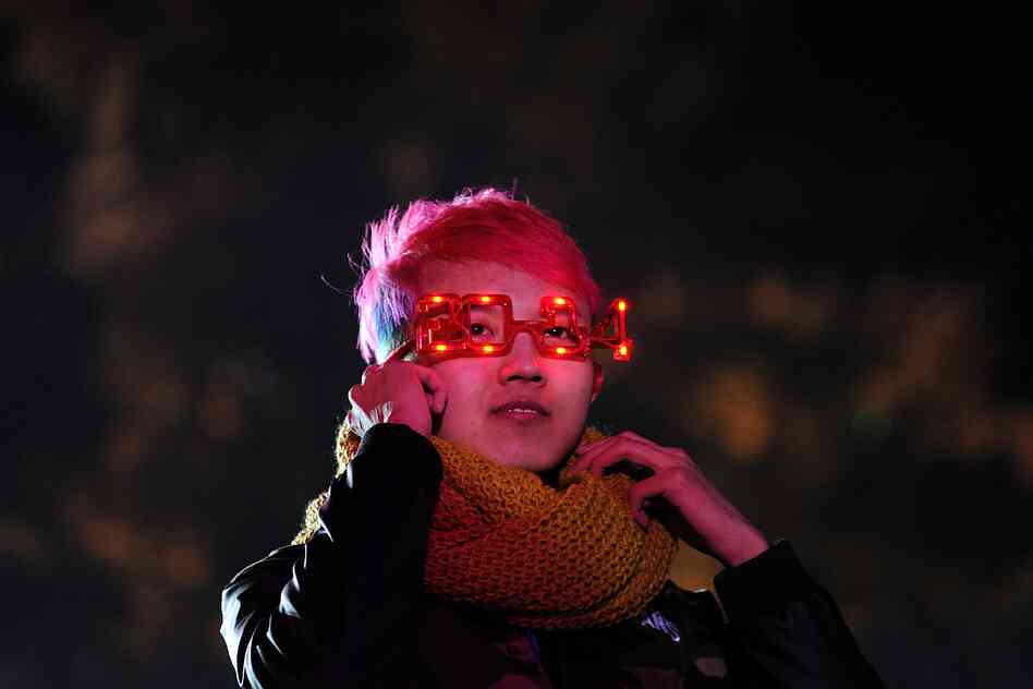 A reveler takes part in festivities during a New Year countdown event at the Great Wall in Beijing. Hundreds of people gathered at the Great Wall to celebrate the New Year.