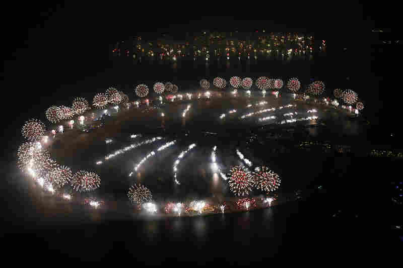Fireworks explode over Palm Jumeirah in Dubai to celebrate the new year in a dazzling bid for a new world record. The glittering fireworks display that lasted around six minutes spanned over 60 miles of the Dubai coast.