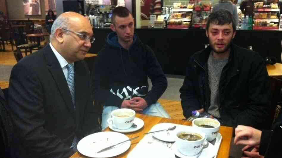 Keith Vaz, a British member of Parliament and chairman of the home affairs select committee (left), greets arrivals at Luton Airport, including Victor Spirescu (right) on Wednesday. The first Romanians and Bulgarians with unrestricted access to the U.K. labor market have begun to arrive despite last-ditch efforts to prevent a feared wave of fresh immigration.