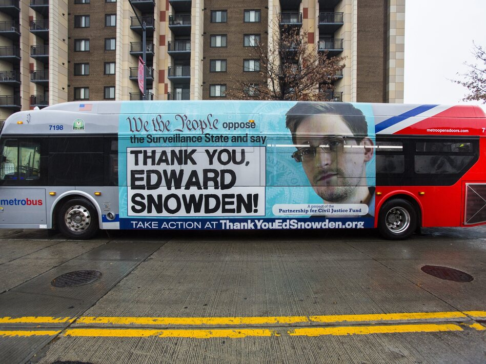 An advertisement thanking NSA leaker Edward Snowden appears on the side of a Metrobus in downtown Washington, D.C., in November.