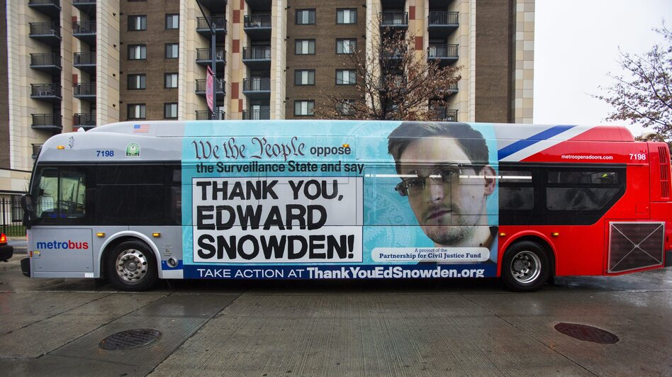An advertisement thanking NSA leaker Edward Snowden appears on the side of a Metrobus in downtown Washington, D.C., in November. (EPA /Landov)