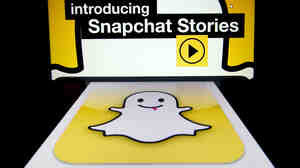 "The logo and a page of mobile app ""Snapchat"" are displayed on tablets. Hack"