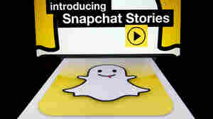 "The logo and a page of mobile app ""Snapchat"" are displayed on tablets. Hackers broke into Snapchat, the popular mobile a"