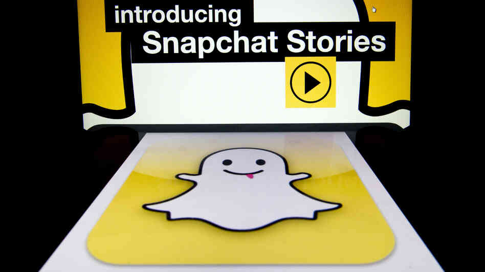 "The logo and a page of mobile app ""Snapchat"" are display"
