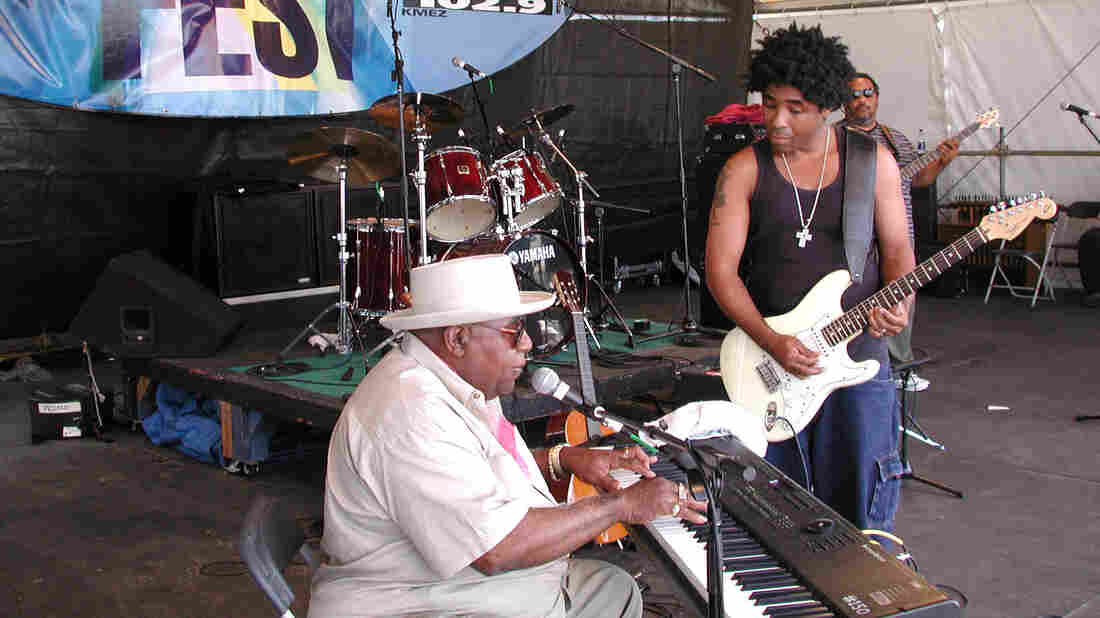 Chris Thomas King plays on the House of Blues stage with his father, Tabby Thomas, in 2001, at the New Orleans Jazz and Heritage Festival.