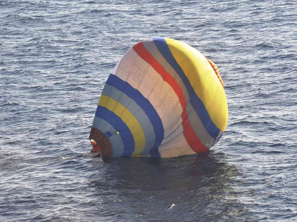 A photo released by Japan's 11th Regional Coast Guard shows a hot air balloon whose Chinese occupant was rescued on Wednesday after a failed attempt to reach a disputed islands chain.