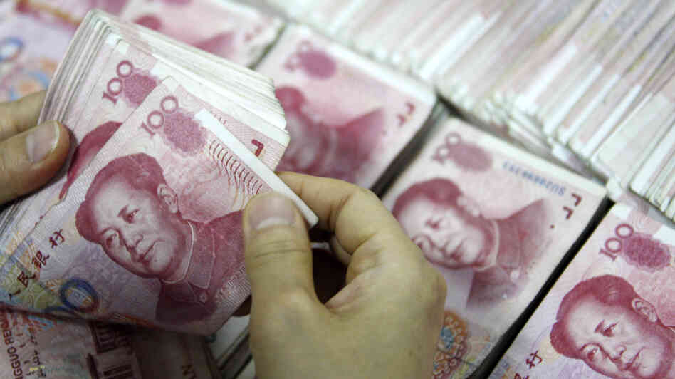 Chinese 100 yuan bank notes being counted at a bank in Huaibei, in eastern China's Anhui province, in 2013. Undeclared income — sometimes the proceeds of corruption, often just of unclear provenance — is estimated to make up a staggering 12 percent of China's GDP.