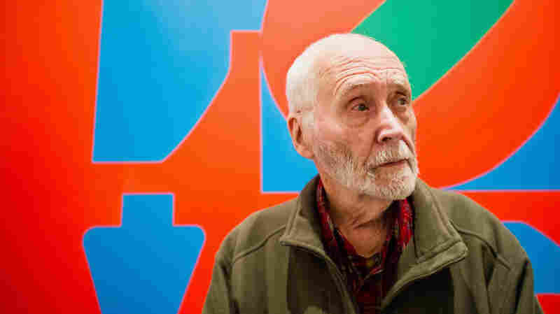 Robert Indiana first emerged as a pop artist in the early 1960s, but he was quickly defined by his 1966 signature work, LOVE, shown behind Indiana in this 2013 photo.