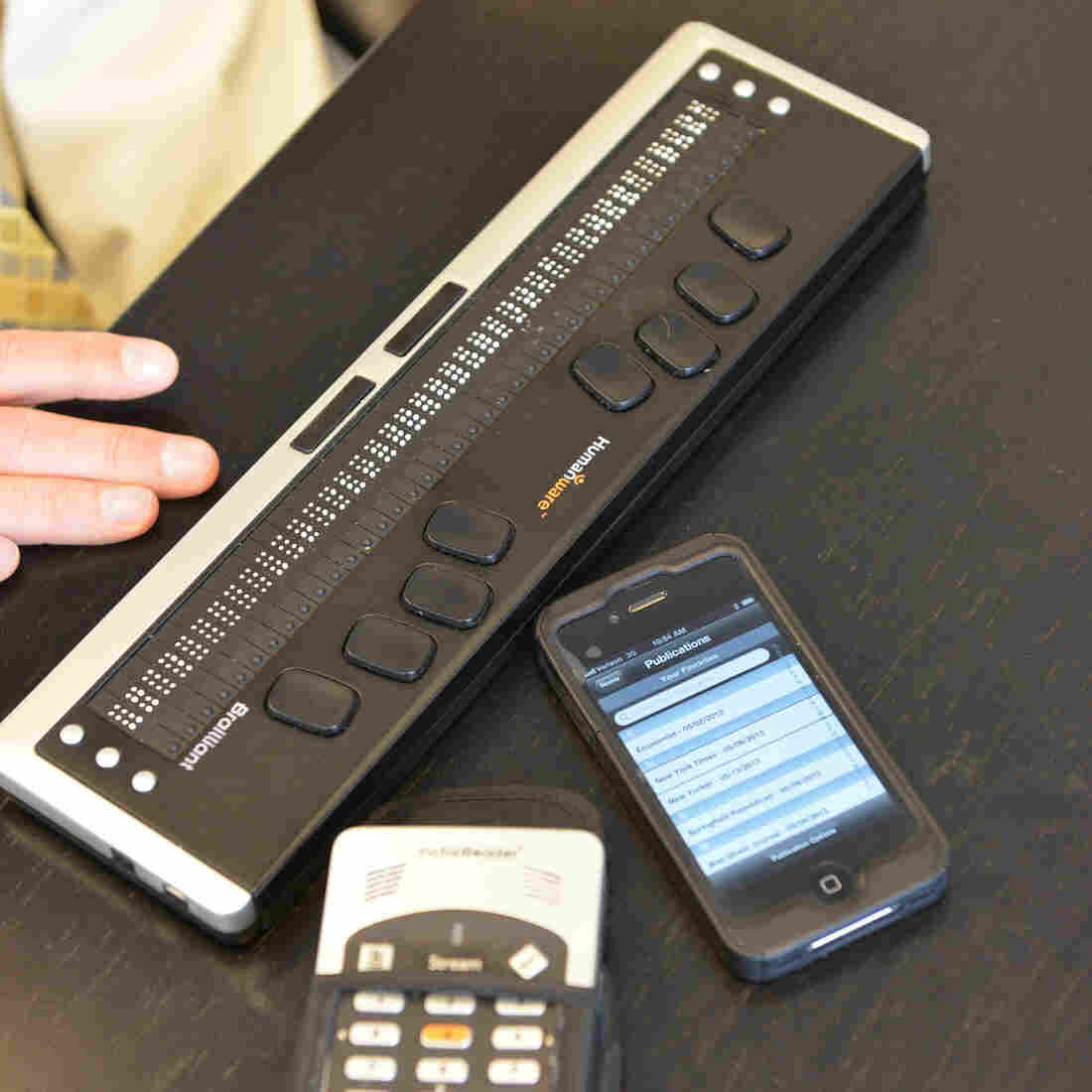 This Braille reader connects to a smartphone.