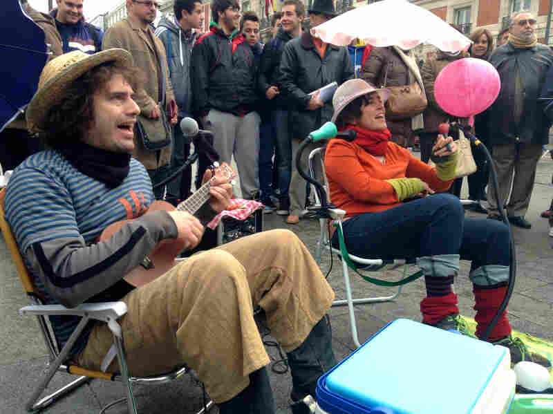 Gerardo Yllera, left, and Laura Nadal play for money in the streets of Madrid. Yllera and Nadal, who form the Potato Omelette Band, are among more than 300 street musicians who were forced last month to audition for the privilege of holding out a hat in the streets of Madrid. A viral video of their audition — complete with lyrics criticizing the new policy — has made them somewhat famous.