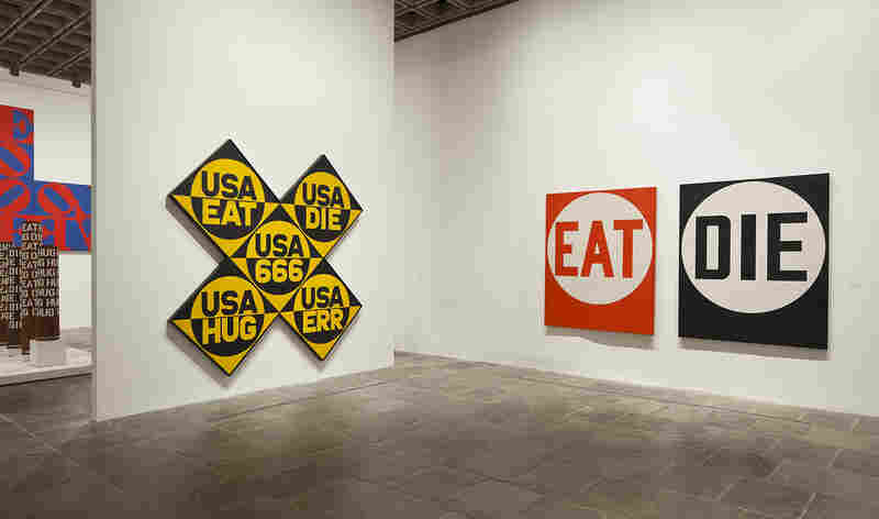 "The Sixth American Dream (USA 666) (left) and Eat/Die were both created before LOVE went viral. The words that appear in these paintings relate to Indiana's life story: ""Hug"" was his mother's word for affection and ""eat"" was the last word she said before she died."