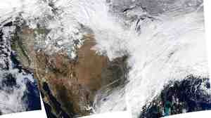 A composite image shows large portions of the United States covered by snow, as a winter storm moved eastward across the country Thursday.