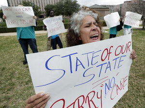 Maria Webster joins others protesting Texas Gov. Rick Perry's stance against the Affordable Care Act in early 2013.