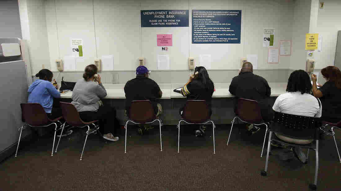 Visitors use the Unemployment Insurance Phone Bank in Sacramento, Calif., on Sept. 20. Tens of thousands in the state lost federal unemployment benefits in December.