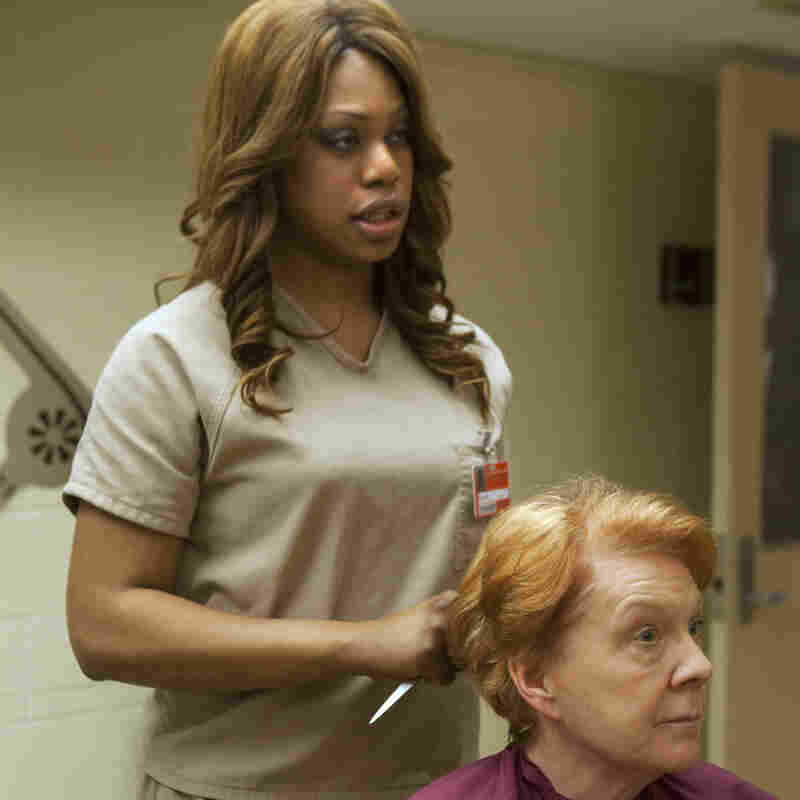 Laverne Cox, left, plays Sophia, a transgender character in Netflix's Orange is the New Black.