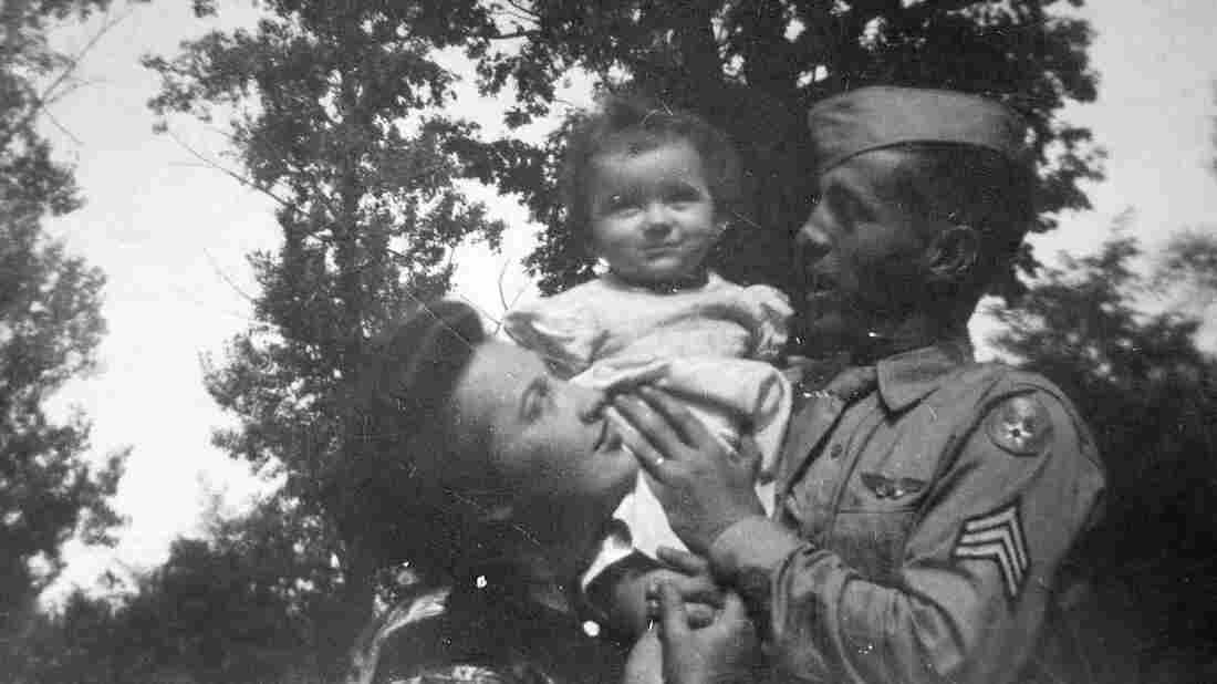 Margaret Ann Wolf Harris with her mother and father, who was home on furlough. He died in World War II a short time later.