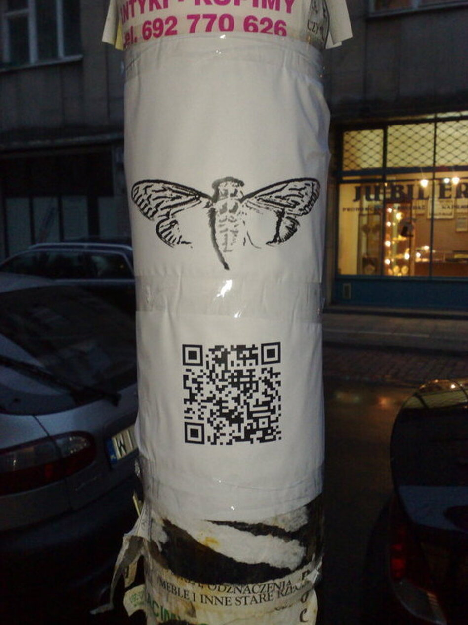 A poster found in Warsaw shows a QR Code for a website related to the Cicada 3301 mystery.