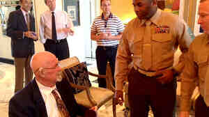 """Hal Faulkner (left), 79, receives his new papers from two Marines after having his military status changed to """"honorable discharge"""" at a recent ceremony. Faulkner was kicked out of the Marine Corps in 1956 for being gay."""