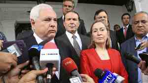 President of Panama, Ricardo Martinelli (left), talks next to Spain's Minister of Public Works and Transport, Ana Pastor, during a news  conference after a meeting at the Presidential Palace in Panama City, Panama, on Monday.