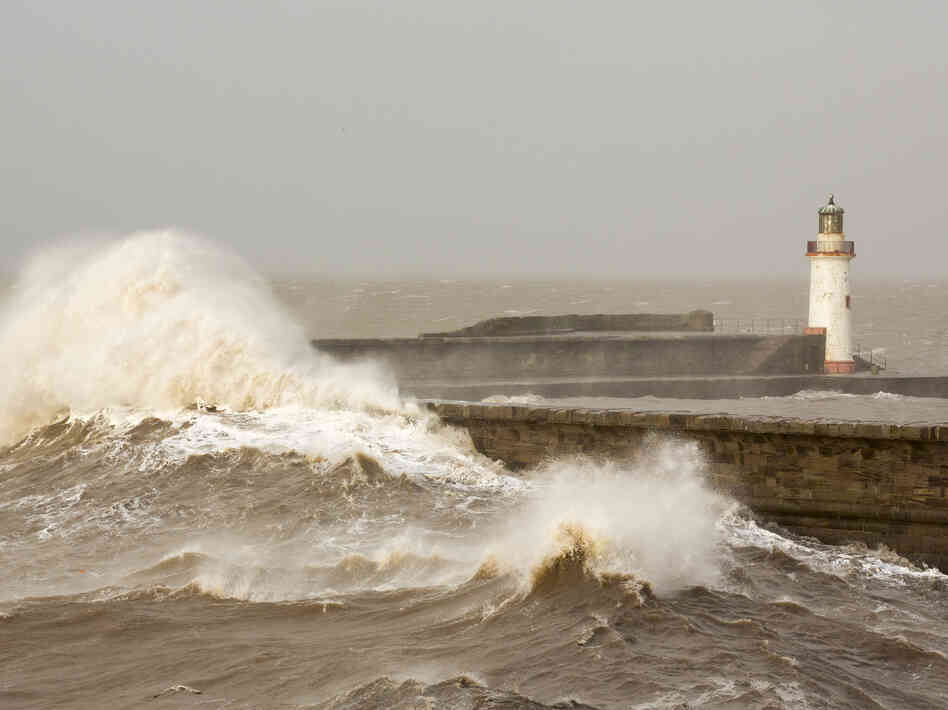 High tide storm waves batter the Cumbrian coast, completely inundating the harbor wall at Whitehaven on Monday
