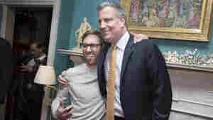 New York Mayor Bill de Blasio poses for pictures with visitors at Gracie Mansion, the official residence of the mayor, during an open house and photo opportunity with the public as part of the inauguration ceremonies on Sunday.