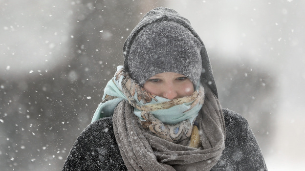 Jenny Hackett walks across a street in St. Louis, Mo., on Sunday. Subzero temperatures are predicted there Monday, with bitter cold sweeping east. (AP)