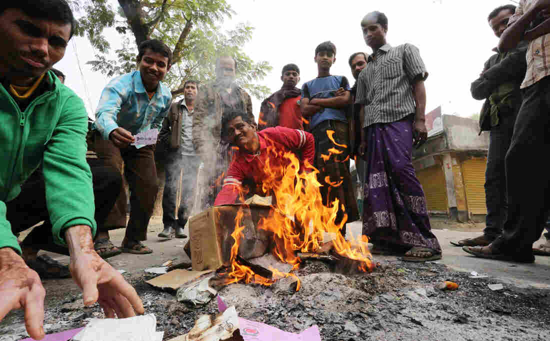 Bangladeshi protesters burn election material Sunday at a polling station in the northern town of Bogra.