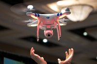 A DJI Phantom 2 flying camera is presented at the media event prior to the International CES show opening in Las Vegas.