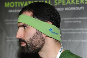 Casey Macioge with AcousticSheep LLC wears RunPhones, a moisture-wicking athletic headband with removable headphones.
