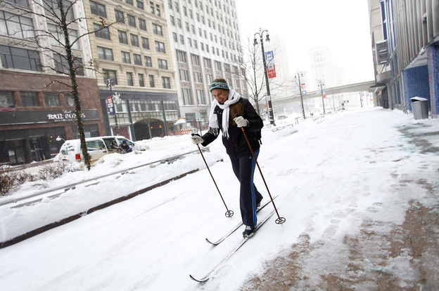 Alison Mueller skies to work through several inches of snow in Detroit as the area deals Monday with record-breaking freezing weather. Wind chill has driven temperatures in Michigan and much of the Midwest down to 50-70 degrees below zero. (Getty Images)