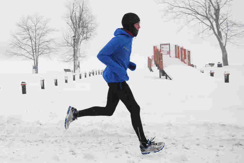 A man runs near Reeds Lake in East Grand Rapids, Mich.