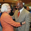 Incoming Texas Longhorns football coach Charlie Strong is embraced by Edith Royal, widow of famed Texas coach Darrell Royal, Monday.