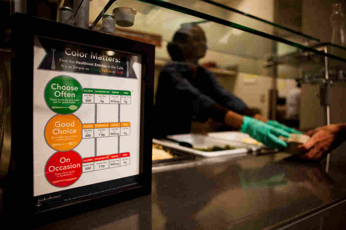 "At NPR's Sound Bites Cafe, all food gets coded with one of three circles: Green is reserved for the most healthful dishes; yellow flags the ""good choices;"" and red signals the high-calorie foods to grab ""on occasion."""