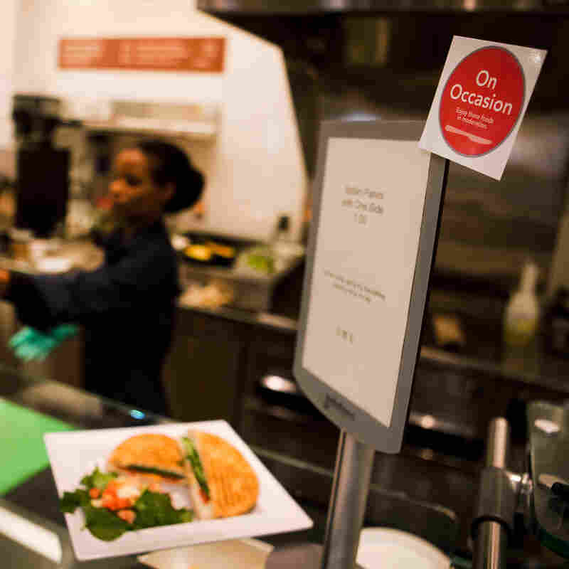 Stop! Do you really want that Italian panini? At NPR's cafeteria, high-fat foods are tagged with a red circle, reminding employees to think twice before indulging in these dishes.