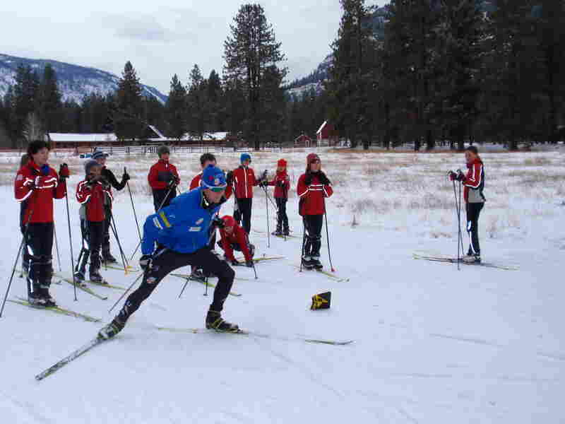 Olympic hopeful Erik Bjornsen demonstrates racing technique at a kids' ski clinic in Mazama, Wash. He hopes to join his sister Sadie at the Winter Olympics.