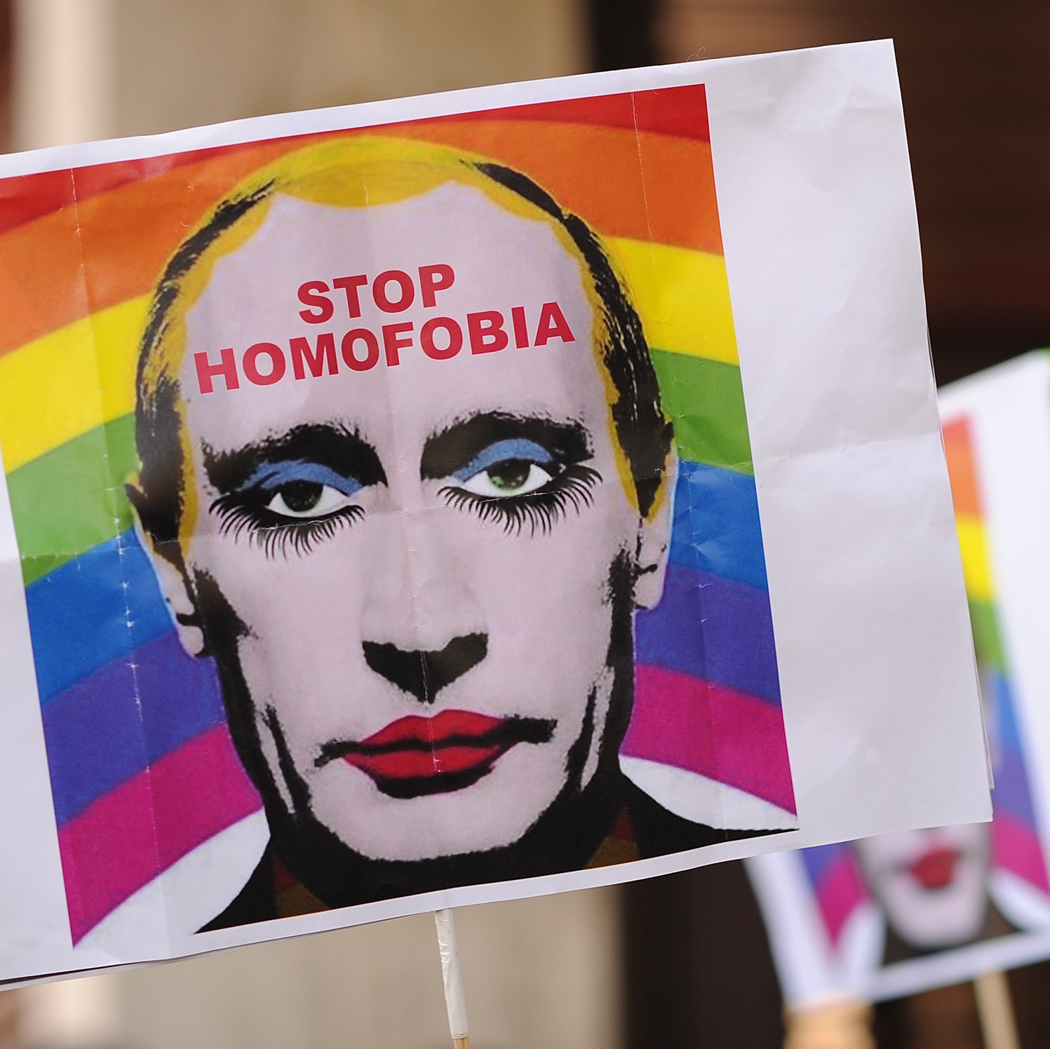 A protester holds up an image representing Russian President Vladimir Putin wearing lipstick during a protest against Russian anti-gay laws opposite the Russian Embassy in Madrid on Aug. 23.