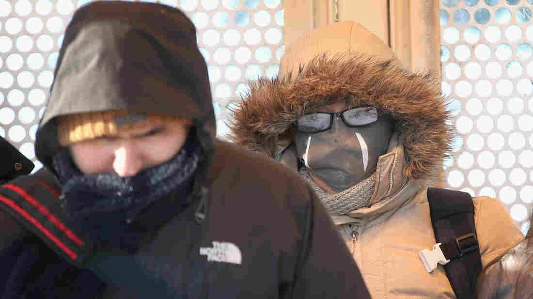 Passengers wait on a train platform in Chicago in below-zero temperatures.