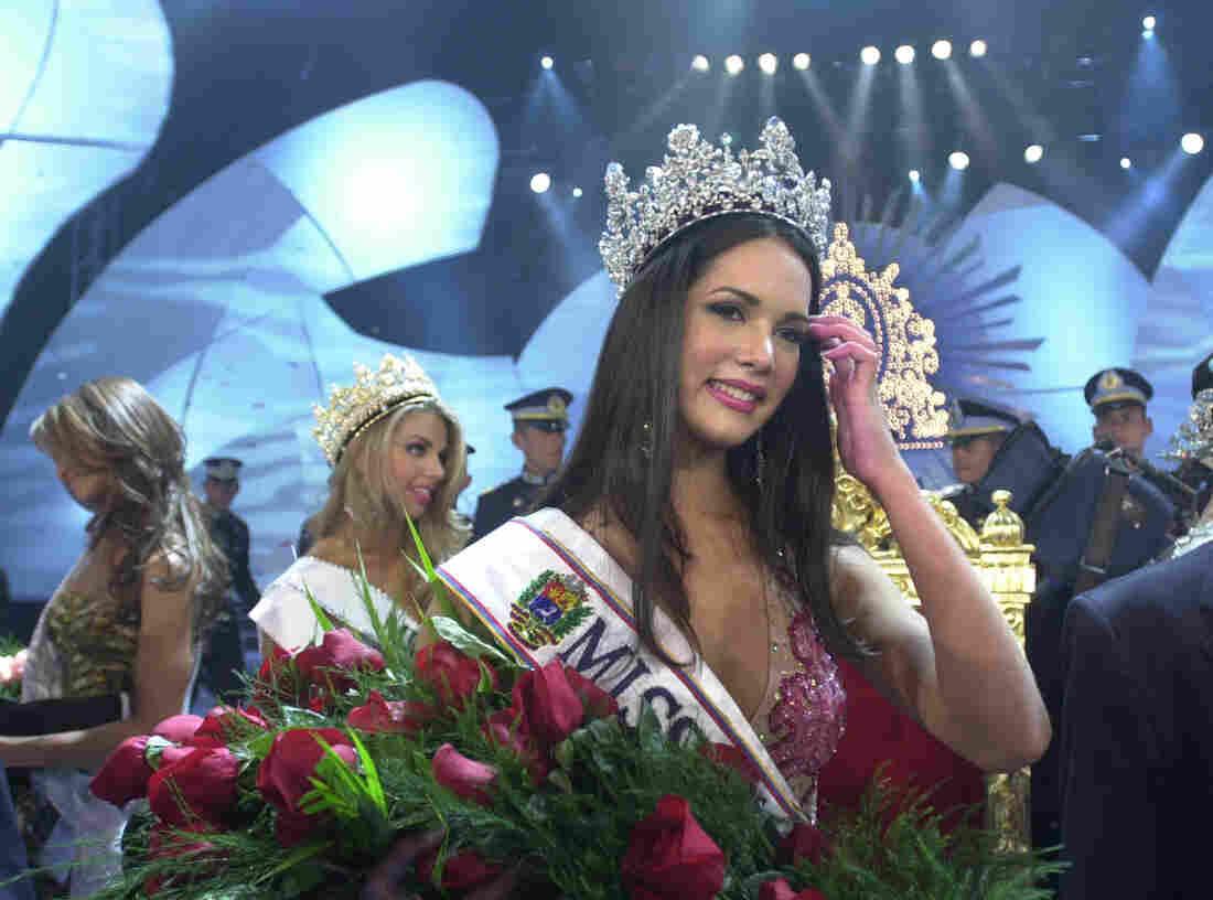 Monica Spear wears her crown after winning the Miss Venezuela title in Caracas, Venezuela, in 2004.