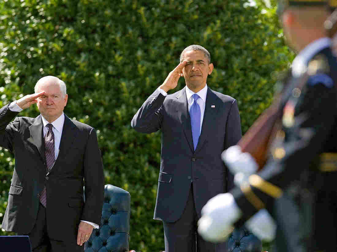 Defense Secretary Robert Gates and President Obama salute during a farewell ceremony for Gates on June 30, 2011.