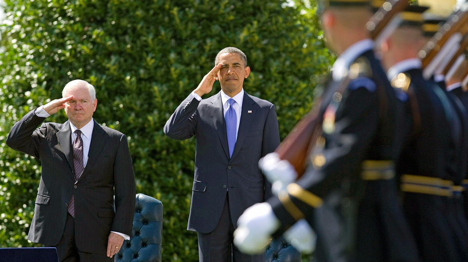 Defense Secretary Robert Gates and President Obama salute during a farewell ceremony for Gates on June 30, 2011. (AP)