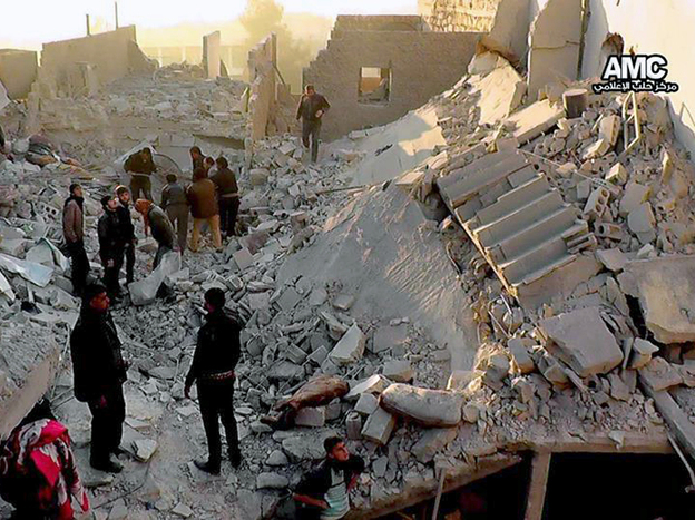 Syrians inspect the rubble of destroyed buildings following a government airstrike in Aleppo, in this image provided Monday that was taken by a citizen journalist.