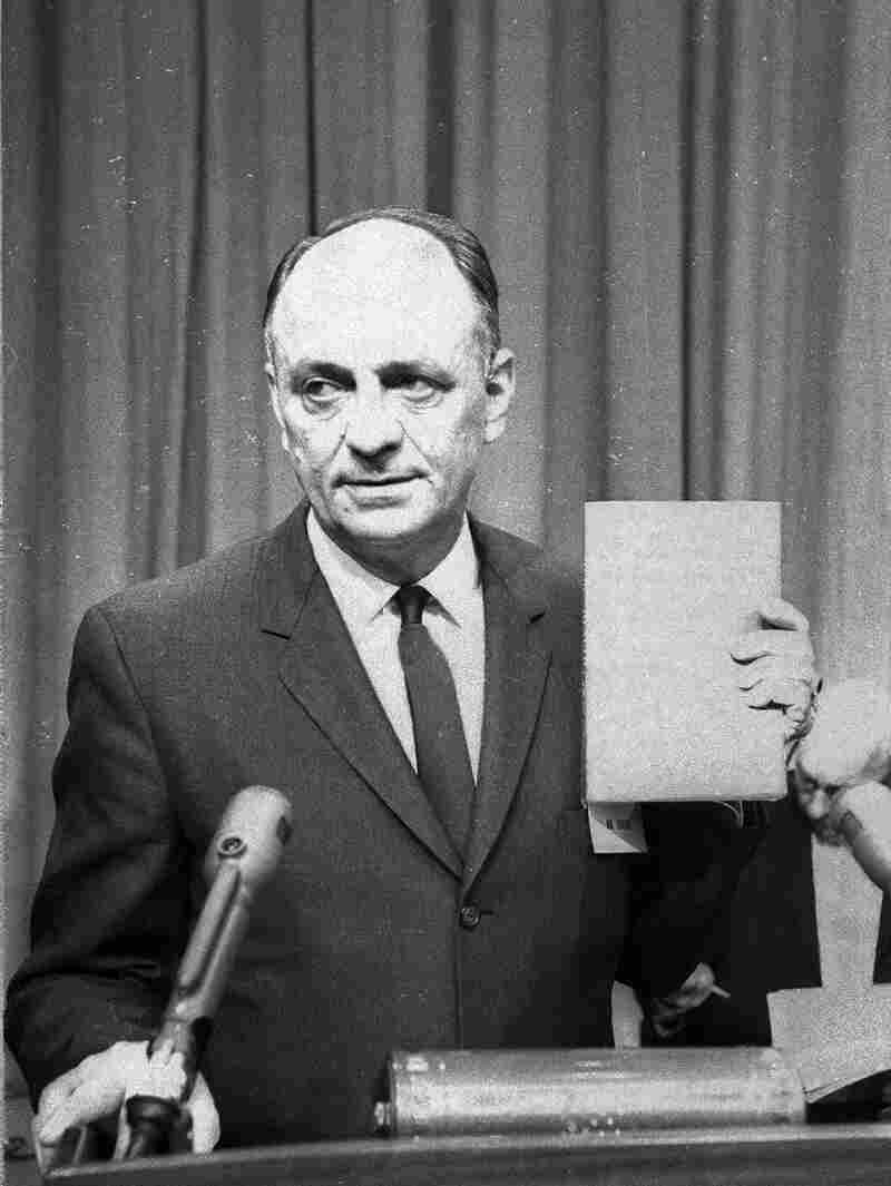 Surgeon General Luther Terry holds a copy of the 387-page report that connected smoking to lung cancer and heart disease on Jan. 11, 1964.