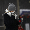 Dealing with it in Detroit: A woman protects her face from the cold on Monday.