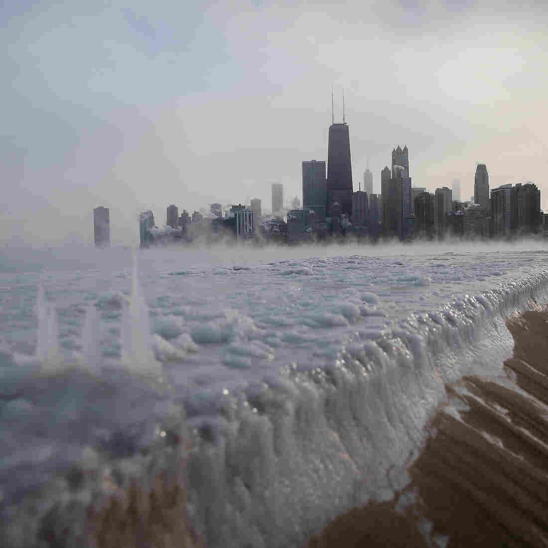Ice has built up along Lake Michigan in Chicago as temperatures have plunged in recent days. A dip in the polar vortex is to blame.