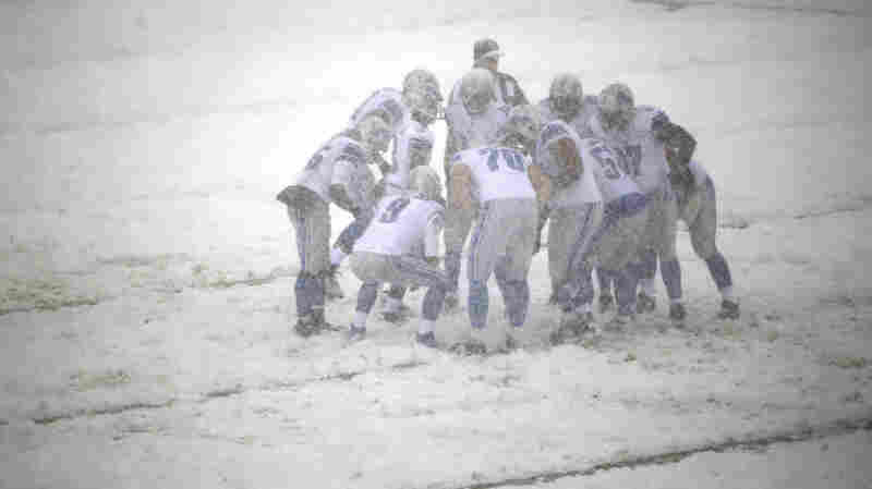 The Detroit Lions huddle during a snowstorm in the first half of a game against the Philadelphia Eagles in December.