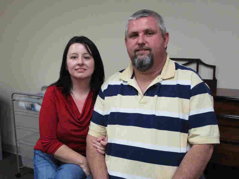 Thomas Vinson, an unemployed coal miner, with his wife, Angela. He says he's grateful for short-term federal help, but he's worried about his future.
