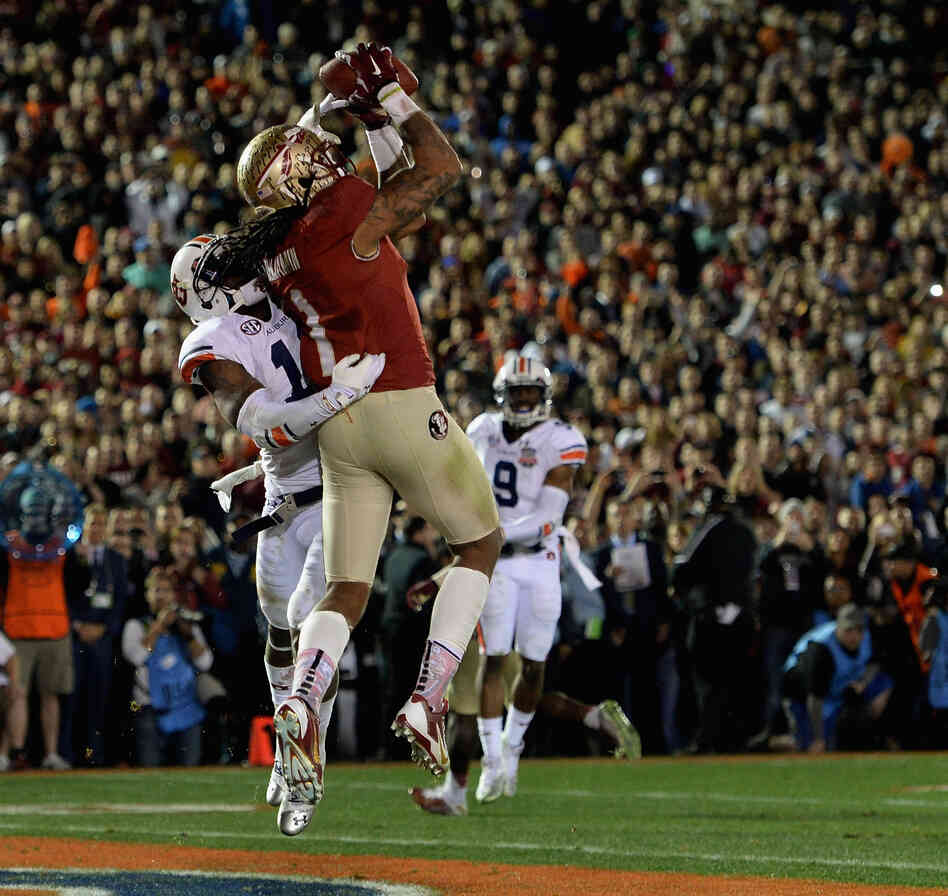 The winning catch: Wide receiver Kelvin Benjamin of the Florida State Seminoles catches the 2-yard pass for a touchdown that put his team ahead for good with just 13 seconds left in the game.