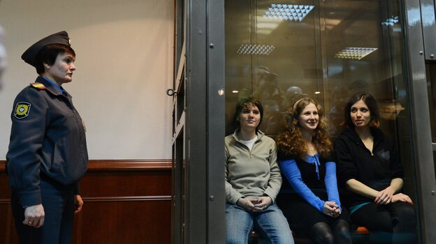 Pussy Riot members Yekaterina Samutsevich (left), Maria Alyokhina and Nadezhda Tolokonnikova sit in a glass-walled cage in a Moscow court on Oct. 10, 2012.