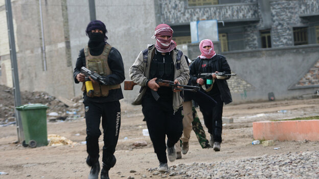 Gunmen patrol during clashes with Iraqi security forces in Fallujah, on Jan. 5, 2014. Al-Qaida has been battling to take back both Ramadi and Fallujah in Anbar province in Iraq.